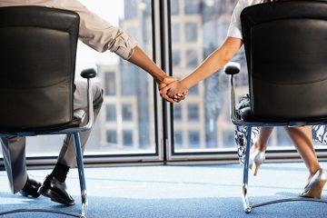 office romance holding hands