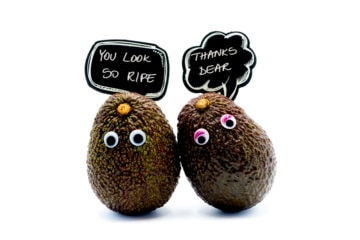 Two avocados complimenting each other representing compliments for girls that actually work