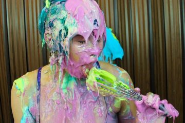 a girl covered in different creams as part of sploshing