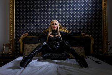 Dominatrix on a bed