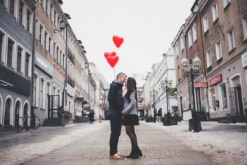 couple on the street with heart balloons